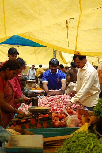 Buying veggies in the rain
