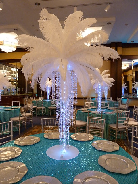 Crystal chandelier light up centerpiece with feathers at the top for a