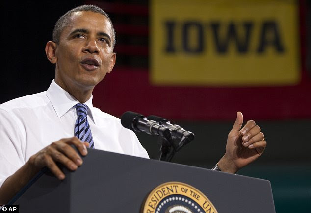 Campaigner in chief? Barack Obama has been assiduously visiting swing states; he is pictured earlier this week speaking in Iowa