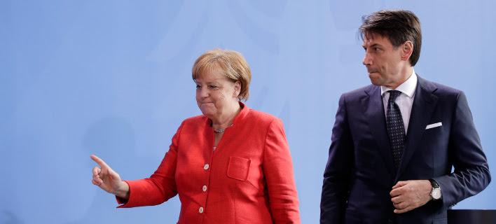 Η Γερμανίδα Καγκελάριος Ανγκελα Μέρκελ και ο Ιταλός Πρωθυπουργός, Τζουζέπε Κόντε -Φωτογραφία:AP Photo/Markus Schreiber