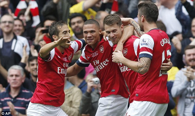 In the goals: Aaron Ramsey celebrates with teammates after scoring against Stoke