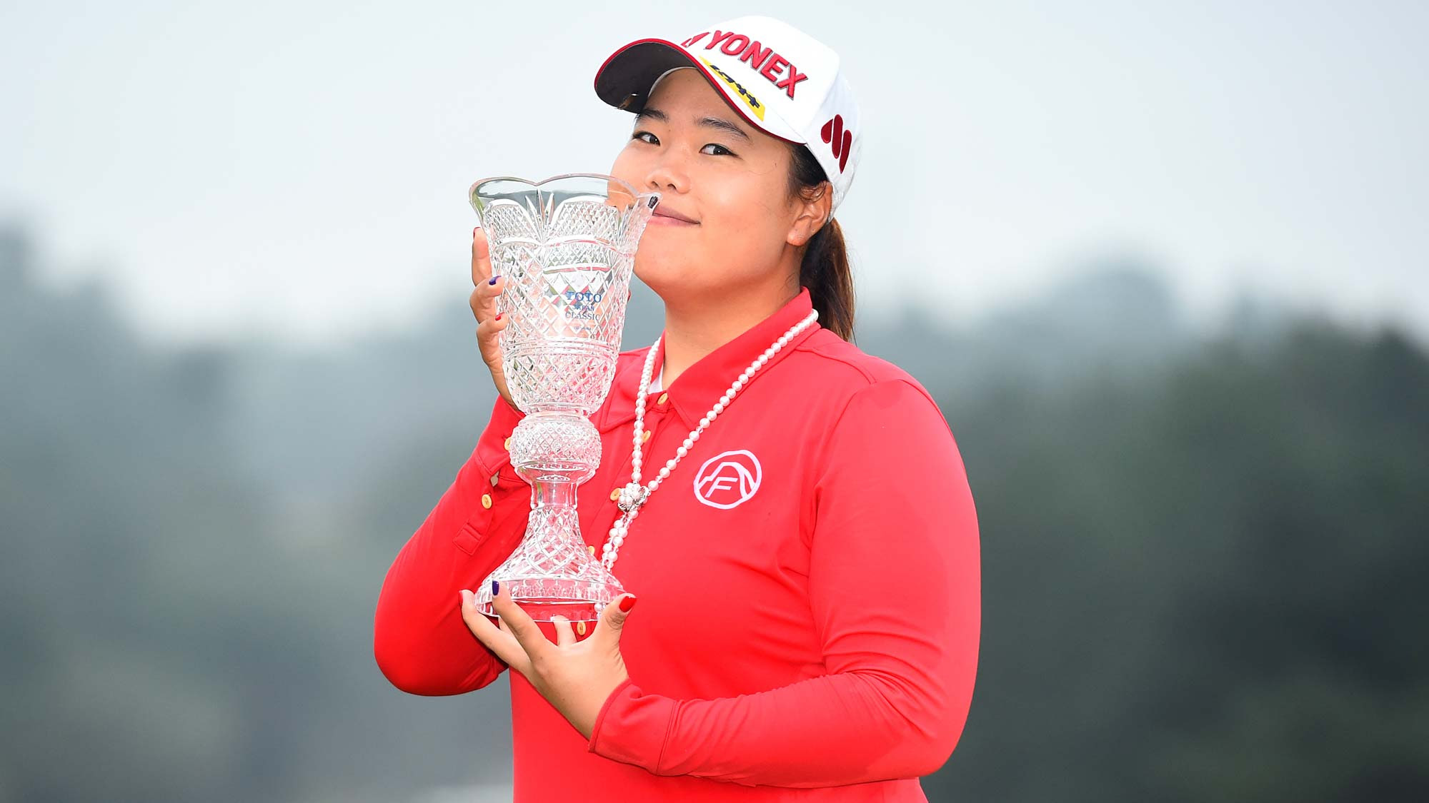 Sun-Ju Ahn holds TOTO Japan Classic trophy