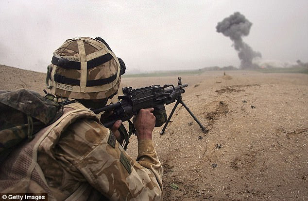 A British commando fires at Taliban near Kajaki in the Afghan province of Helmand in 2007 (file photo)