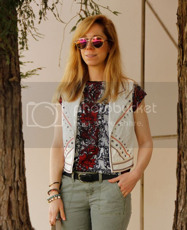 LA fashion blogger The Key To Chic wears a faux leather Southwestern vest with Mossimo moto pants, and a Kate Spade Penny bag.
