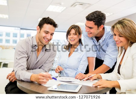 Business people working as a team at the office - stock photo
