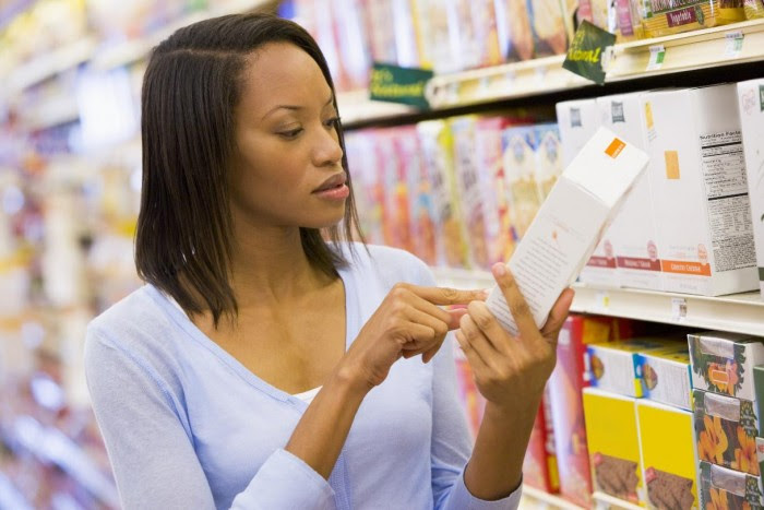 Woman Reading Food Label CanStockPhoto