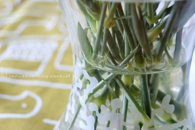 Carnation stems in favourite vase