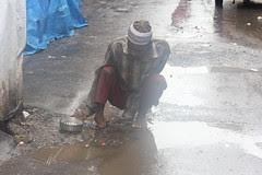 The Muslim Beggar on a Wet Rainy Day .. Ramzan by firoze shakir photographerno1
