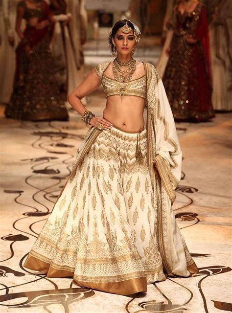 Reddish and off white Rohit BAL Bridal Dresses ? Designers
