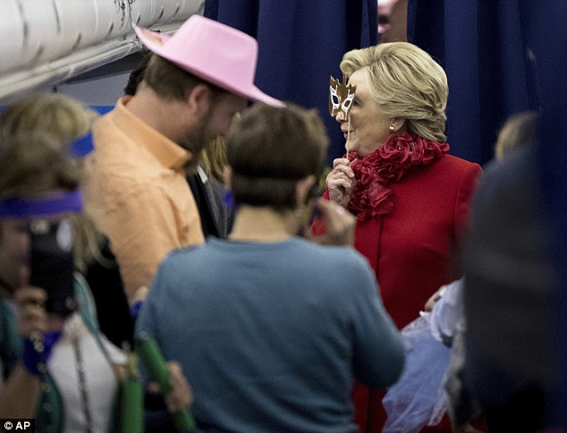 Boo! Campaign aide Greg Hale sported a pink cowboy hat. Female aides word blue ribbons on their hair