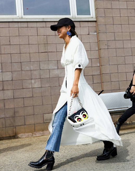 Le Fashion Blog NYFW Streetstyle Baseball Hat White Dress Over Raw Hem Jeans Black Chunky Heeled Boots Via Vogue