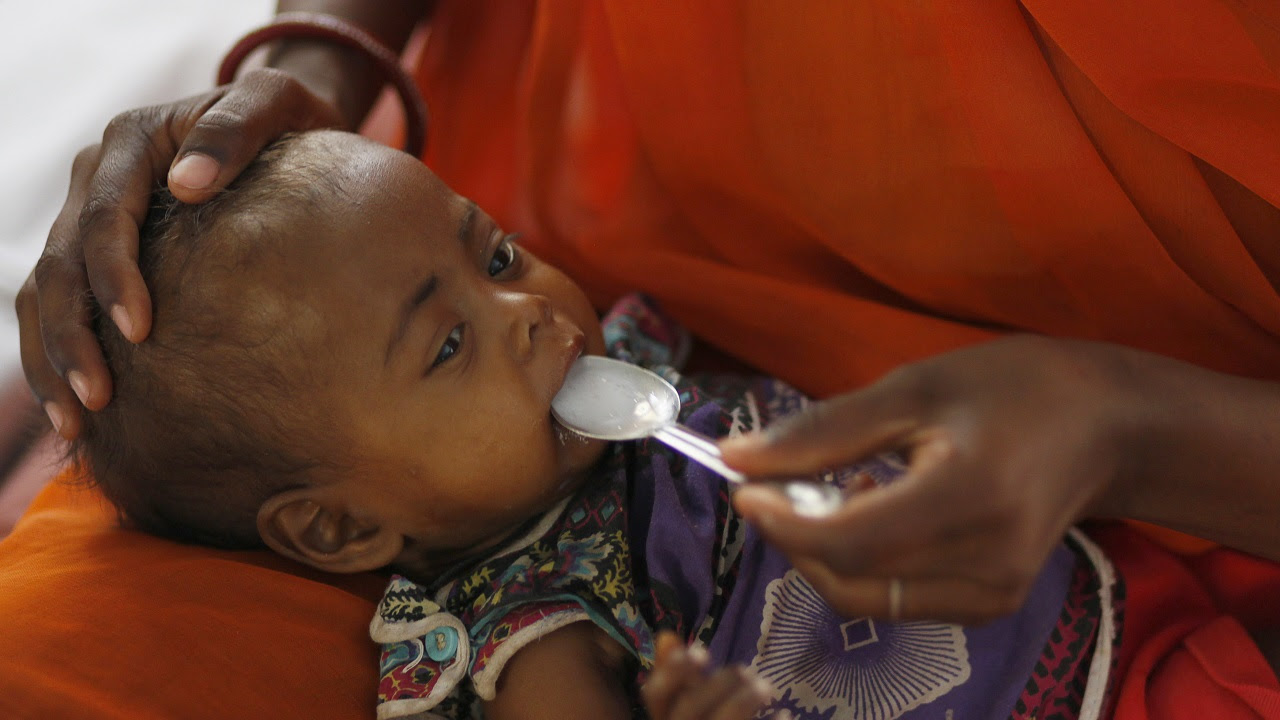 A mother feeds her malnourished child in the Nutritional Rehabilitation Centre of Sheopur district in Madhya Pradesh. India ranked 65th out of 84 countries in the Global Hunger Index of 2009, below countries including North Korea and Zimbabwe a decade ago. Reuters