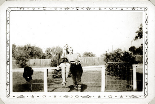 Our Laura in jodhpurs with friend on fence