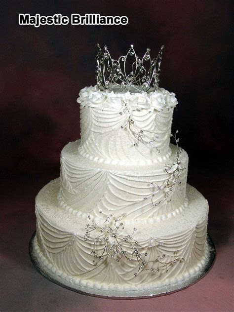 whimsical wedding cakes with tiara topper   three tier