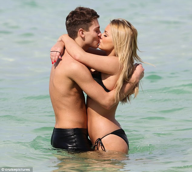 Smitten: Joey Essex and Sam Faiers put on an amorous display as they hit the beach at Dubai's Grosvenor House Hotel