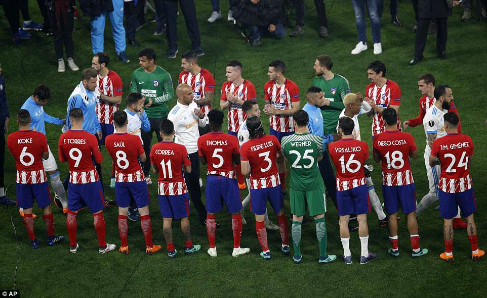 Atletico players give their defeated opponents a guard of honour as they go up to claim their runners-up medals