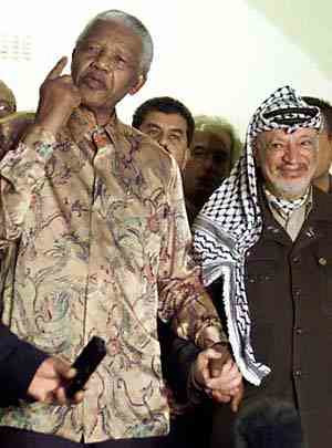 Nelson Mandela and the late PLO leader Yassir Arafat. People in Palestine are commemorating the fifth anniversay of his death in 2004. by Pan-African News Wire File Photos