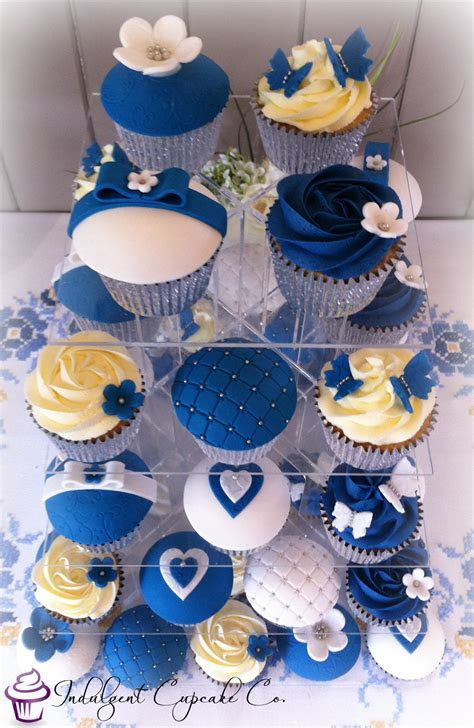 Royal blue, white & silver wedding anniversary cupcakes