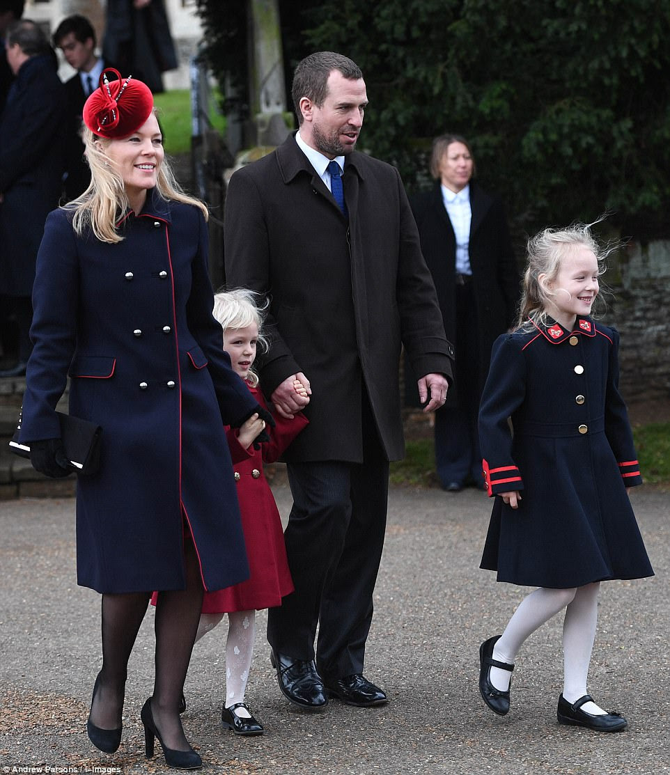 Peter and Autumn Phillips are pictured with their children Isla Phillips and Savannah Phillips before the church service