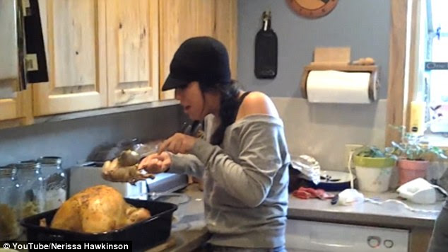 She suddenly becomes hysterical and shrieks: 'Oh my God, what is this? There's a baby turkey in the turkey!'