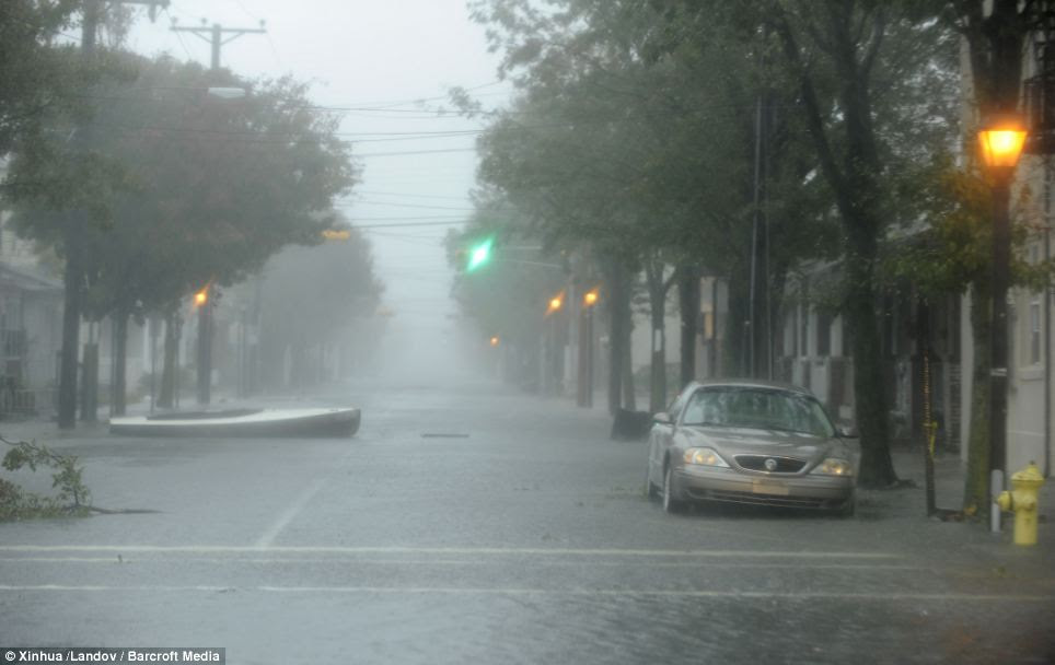 Ominous sight: An empty street is seen in deserted Atlantic City as Sandy raced towards the helpless holiday town