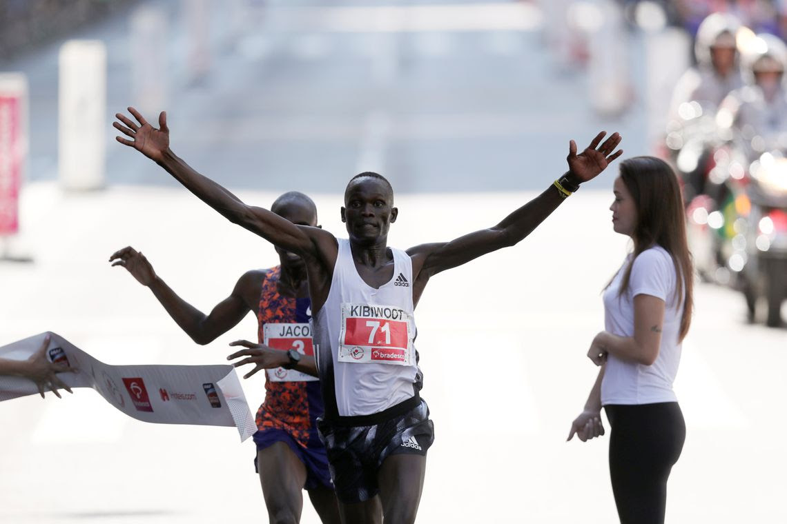 "Kibiwott Kandie of Kenya crosses the finish line after passing Uganda's Jacob Kiplimo at the last moment to win the annual ""Sao Silvestre Run"", an international race through the streets of Sao Paulo, Brazil December 31, 2019. REUTERS/Amanda"