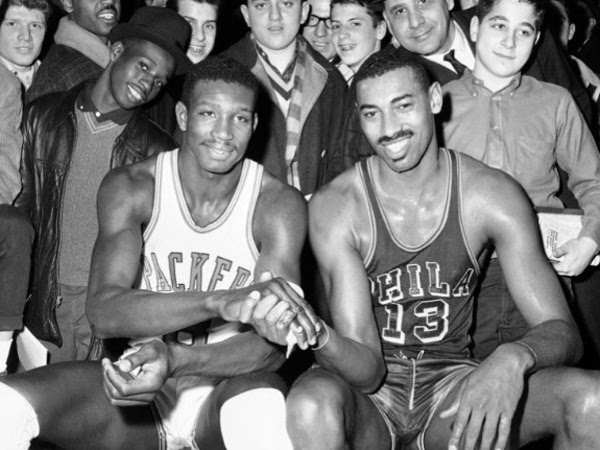 Wilt Chamberlain (right) star basketball player for the Philadelphia Warriors and Walt Bellamy, Chicago Packers´ rookie sensation, pose together prior to ballgame between their teams, March 15, 1962 in Chicago. Bellamy, a Hall of Fame center who ended his career averaging 20.1 points and 13.7 rebounds in 14 seasons in the NBA, died Saturday. He was 74. <br /><br />