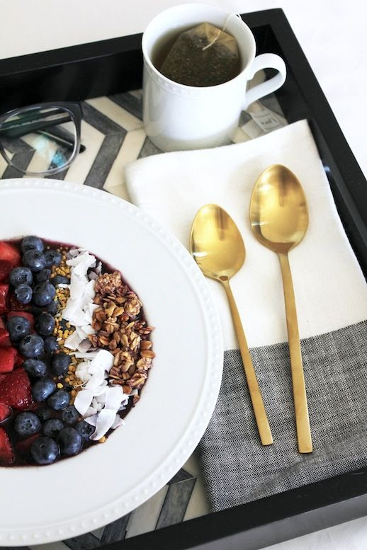 Le Fashion Blog Stylish Breakfast In Bed Chevron Tray Gold Spoons Flatware Linen Napkin Acai Bowl White Staccato Bowl West Elm Crate Barrel Home Decor Simon Malls