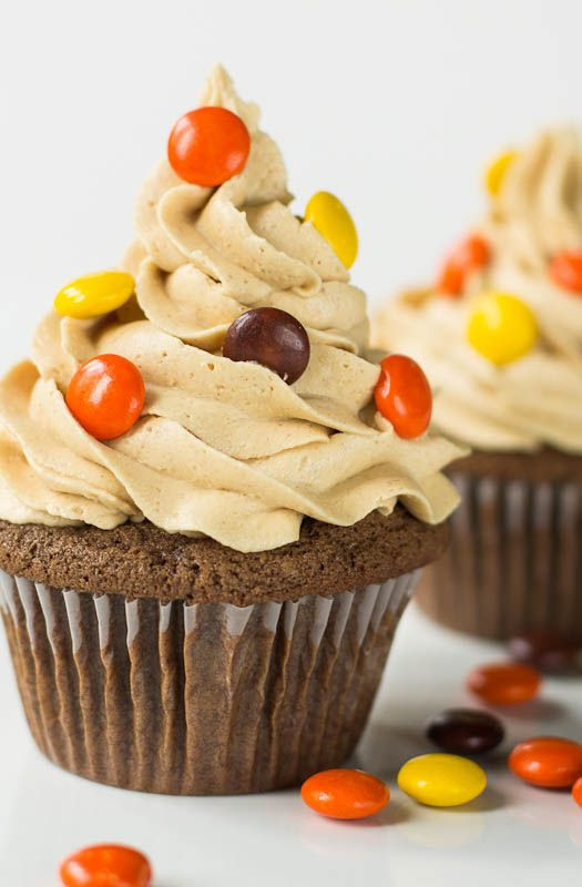 Double Reese's Cupcakes with a peanut butter cup hidden on the bottom.