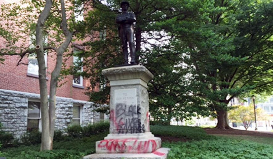 Depicted is a Confederate monument in Rockville, Md., shown here as defaced in a 2015 vandalism incident. The statue, dedicated to Montgomery County residents who fought for the South, will be relocated to the historic White's Ferry in Dickerson, Md. (NBC Washington) [http://media.nbcwashington.com/images/1200*675/confederate+statue.jpg]