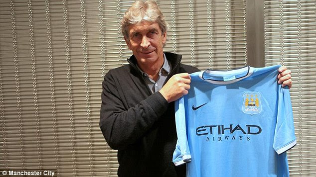 Touchdown in England: Manuel Pellegrini showing off the Manchester City shirt for the first time