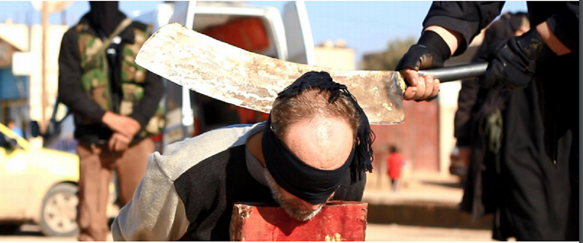 Islamic State prepares to behead man for committing apostasy. (Screengrab/Dabiq).