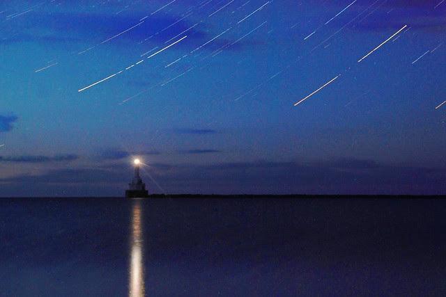 A lighthouse under a starry sky.