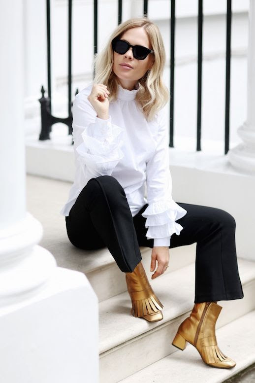 Le Fashion Blog White Ruffle Sleeve Blouse Black Tailored Pants Metallic Gold Boots Via We The People Style