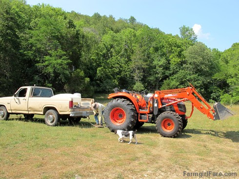 (11) Getting ready to tow the dead truck with the live tractor - FarmgirlFare.com