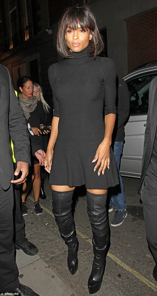Fine form:The mother-of-one donned a black, figure-hugging roll-neck dress, which flaunted her toned curves
