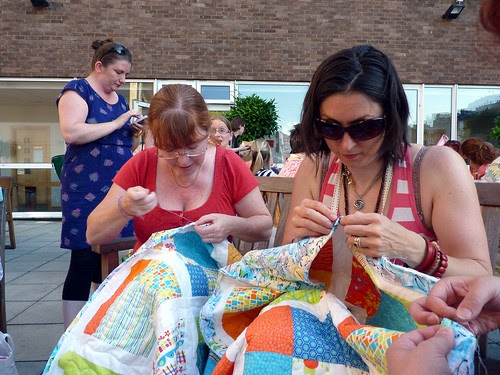Susan, Jo and Katy hurry to finish a Siblings Together Quilt