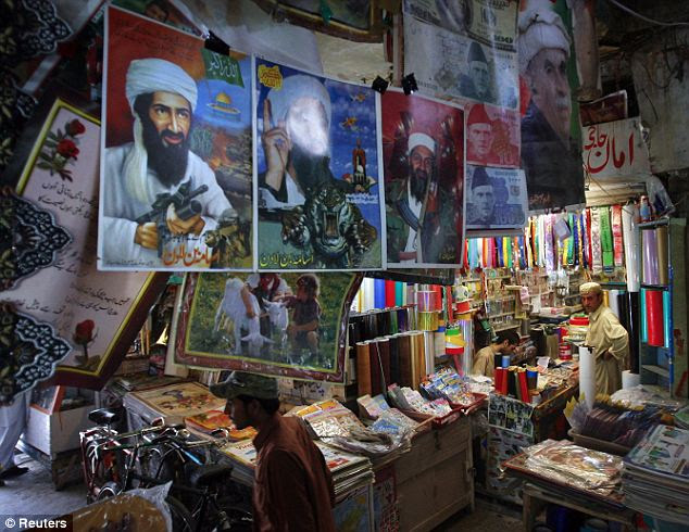 Folk hero: Posters of Osama bin Laden are displayed for sale at a market in Quetta, Pakistan. It's almost inevitable that the bin Laden mythology will not end with the bullet in his head.