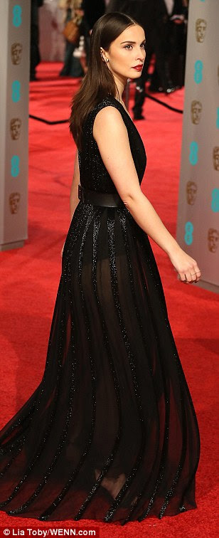 Racy display: Poldark actress Heida Reed went for a beautiful yet seriously sexy look in a plunging black dress with a sheer skirt, a delicate necklace on her bare chest