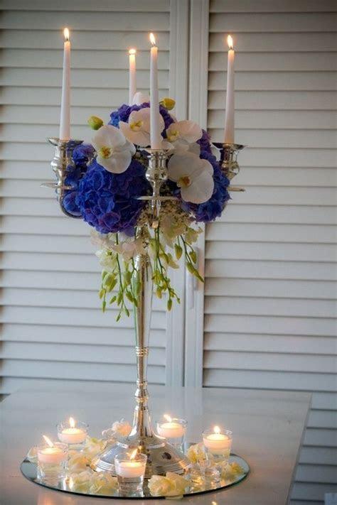 Royal blue centerpiece on a mirror base.   Mirror