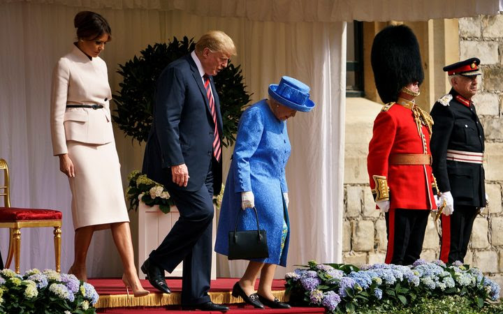 Britain's Queen Elizabeth II escorts US President Donald Trump and US First Lady Melania Trump into Windsor Castle after inspecting troops at Windsor Castle in Windsor, west of London, on the second day of Trump's UK visit.