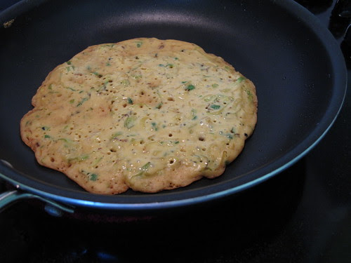 Tortillita cooking on pan