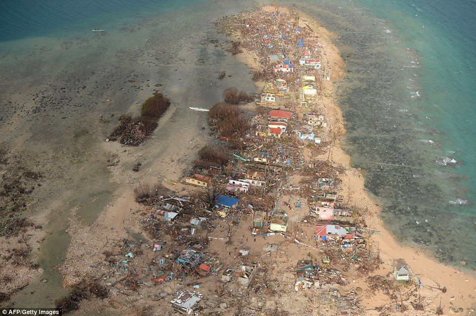 This aerial shot shows destroyed houses on Victory Island near the town of Guiuan in Eastern Samar province, central Philippines