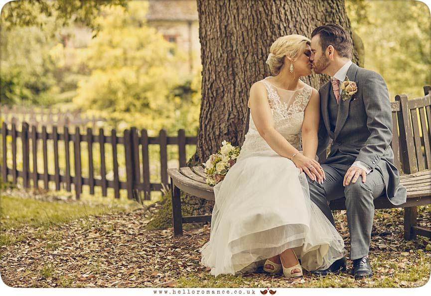 Bride & Groom kissing on romantic bench - www.helloromance.co.uk