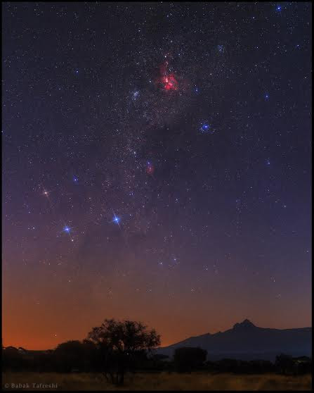 At the break of dawn the southern Milky Way is photographed over Mount Kilimanjaro, as seen from Amboseli National Park, Kenya. The Great Carina Nebula is the red cloud at top. Constellation Crux or the Southern Cross appear on the left. On the Earth is the second peak of Mount Kilimanjaro reaching 5149 m high, known as Mawenzi (meaning the moon in Swahili). Credit and copyright:  Babak A. Tafreshi.