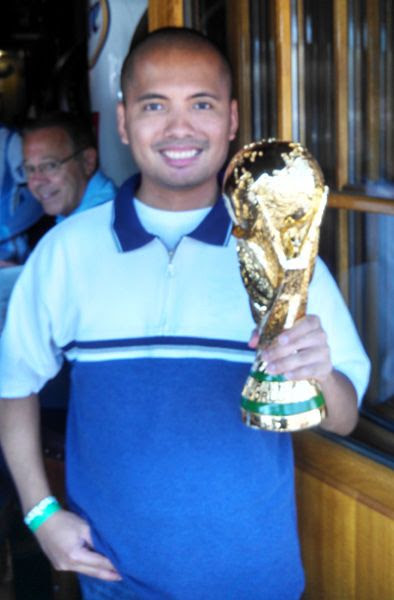 Getting photobombed while holding a replica of the World Cup trophy at the Legends sports bar in Long Beach, CA...on July 13, 2014.