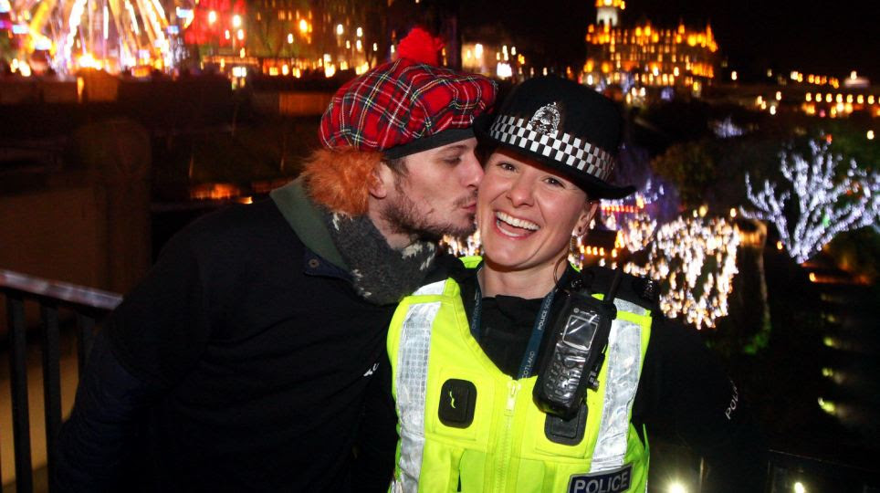 What a happy start to the new year!  Alex Thomson steals a kiss from PC Heather Clark of Police Scotland