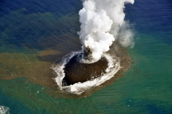 An erupting undersea volcano forms a new island off the coast of Nishinoshima, a small unihabited island in the southern Ogasawara chain of islands. The image was taken on November 21, 2013 by the Japanese Coast Guard.