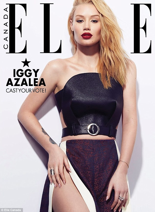 Flaunting it: The Australian rap artist also features on alternate cover in a bondage-inspired blouse and skirt with a thigh-high slit