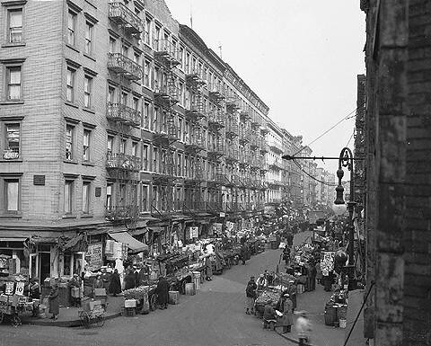 Rivington is the cross street, but the street with all the pushcarts is unidentified (it is probably Orchard Street), October 28, 1936.